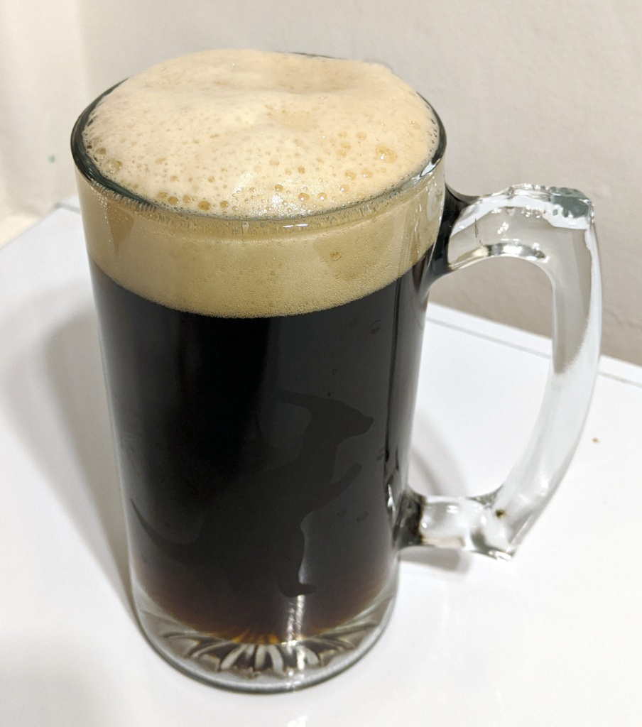 tall mug of dark lager with tan colored head