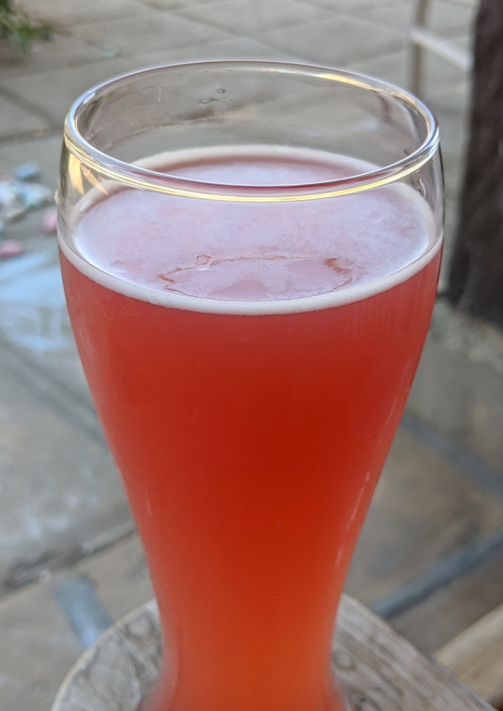 deep pink beer in Belgian wit glass